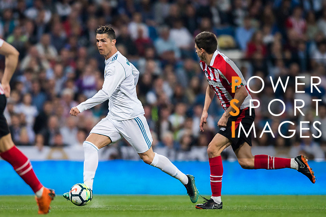 Cristiano Ronaldo (L) of Real Madrid is followed by Ander Iturraspe Derteano of Athletic Club de Bilbao during the La Liga 2017-18 match between Real Madrid and Athletic Club Bilbao at Estadio Santiago Bernabeu on April 18 2018 in Madrid, Spain. Photo by Diego Souto / Power Sport Images