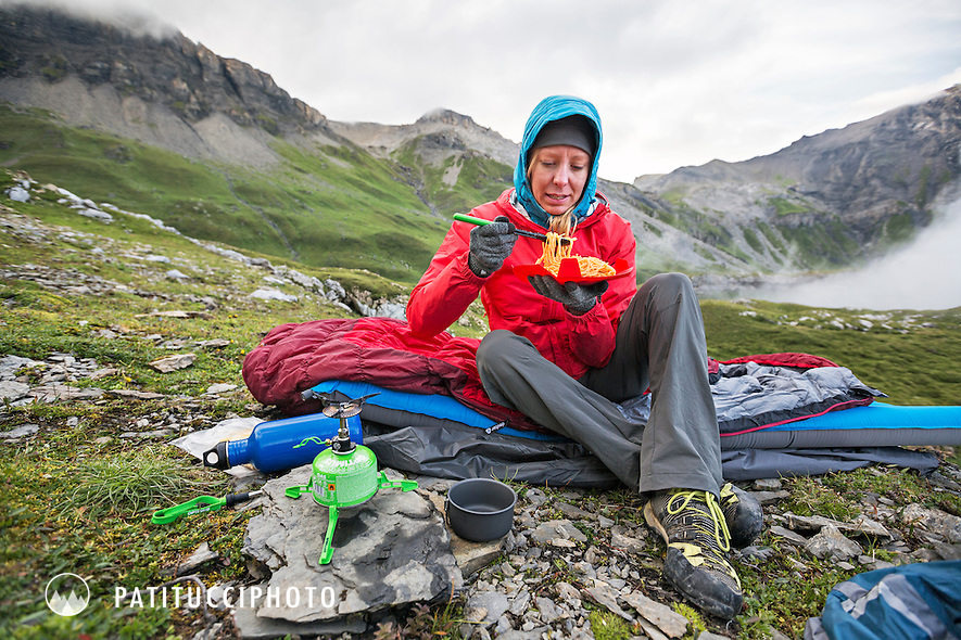Eating a spaghetti dinner in camp, Swiss Alps