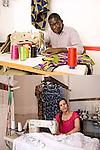 CUCIRE CON GLI OCCHI<br /> Malick Niang, sarto<br /> Nabila Ighil, sarta<br /> <br /> Dal basso in su<br /> lo sguardo ti sguarda<br /> ti prende le misure<br /> le annota nella mente.<br /> I rocchetti di filo -cilindri di colore-<br /> la macchina da cucire<br /> toccata con rispetto.<br /> L&rsquo;Africa a Torino &egrave; questa qui<br /> nelle stoffe, nei punti infilati<br /> dentro lo sguardo del sarto<br /> da sotto in su.<br /> <br /> La treccia stretta,<br /> il rosso vivo <br /> dello sguardo<br /> come un ago<br /> bello e dritto,<br /> senza nessuna paura.