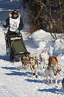 Musher Pete  Kaiser on Long Lake at the Re-Start of the 2011 Iditarod Sled Dog Race in Willow, Alaska.