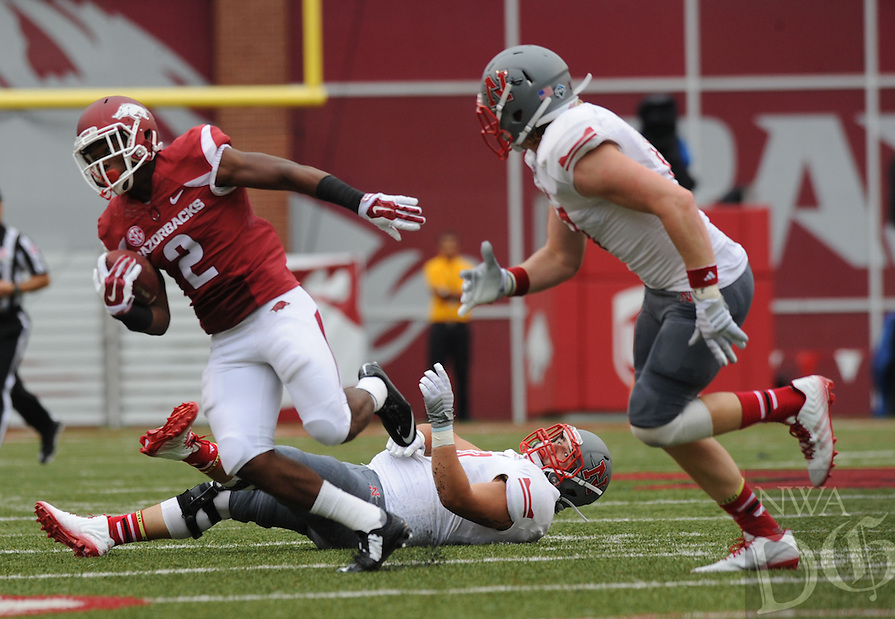 NWA Media/ANDY SHUPE - Arkansas' D.J. Dean (2) carries the ball through the Nicholls defense on his way to the end zone during the first quarter Saturday, Sept. 6, 2014, at Razorback Stadium in Fayetteville