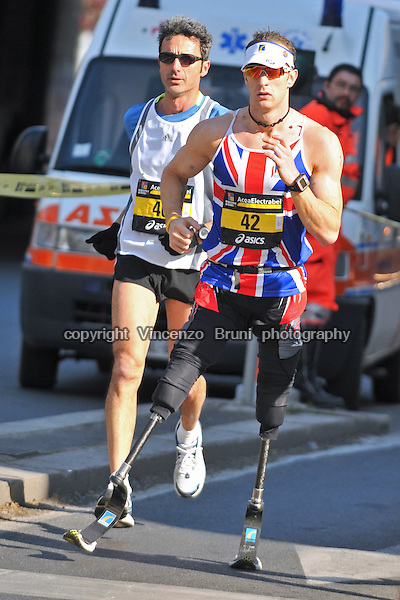 "Richard Whitehead of Great Britain (#42) on his way to establish a stunning PB of 2h56'45"" competing in the 15th Rome Marathon on March 22, 2009 in Rome, Italy. Richard is a paralympic athlete running with special carbon fiber prothesis."