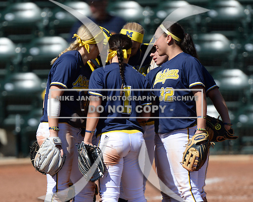 Michigan Wolverines Softball team huddle including outfielder Kelly Christner (21), infielder Abby Ramirez (1), and shortstop Sierra Romero (32) during a game against the Bethune-Cookman on February 9, 2014 at the USF Softball Stadium in Tampa, Florida.  Michigan defeated Bethune-Cookman 12-1.  (Copyright Mike Janes Photography)