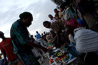 Joseph, a middle age Rastafarian from Jamaica, negotiates with an ethiopian retailer in the main market of Shashamane, a village that hosts more than 300 Rastafarians Families, in Ethiopia on Wednesday March 19 2008.///..Joseph, who has spent his life traveling, visits Shashamane regularly..The Rastafarians, who are mainly from Jamaica, started migrating to Ethiopia 45 years ago, when Haile Selassie, whom they consider to be God incarnate, gave them 500 hectares of land on which to settle..Since the first 12 Jamaican settlers in 1963, the community has grown to over 200 families..The Rastafarian community insists that a mass exodus of Jamaicans to Ethiopia would not be a burden, despite the poverty and economic difficulties faced in the country..Some of them are skilled tradesmen such as carpenters and builders..Others are shop owners and they say that over the decades they have played an important role in the development of Shashamene..In January 2005 there were reports in the media that Bob marley's remains were to be exhumed and then reburied at Shashamane. His wife Rita Marley described Ethiopia as his spiritual home, provoking controversy in Jamaica, where his remains lie..At the beginning of the following month, thousands of fans gathered in Shashamane for a month of celebrations for what would have been Marley's 60th birthday. Until 2005 his birthday celebrations were always held in Jamaica. These events brought Shashamane to wider prominence throughout the world..