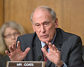 """United States Senator Dan Coats (Republican of Indiana) questions John Koskinen, Commissioner, Internal Revenue Service, as he testifies before the United States Senate Committee on Finance on """"IRS Operations and the President's Budget for Fiscal Year 2016"""" in Washington, D.C. on Tuesday, February 3, 2015.  During his testimony, Koskinen said """"In regard to software, we still have applications that were running when John F. Kennedy was President.""""<br /> Credit: Ron Sachs / CNP"""
