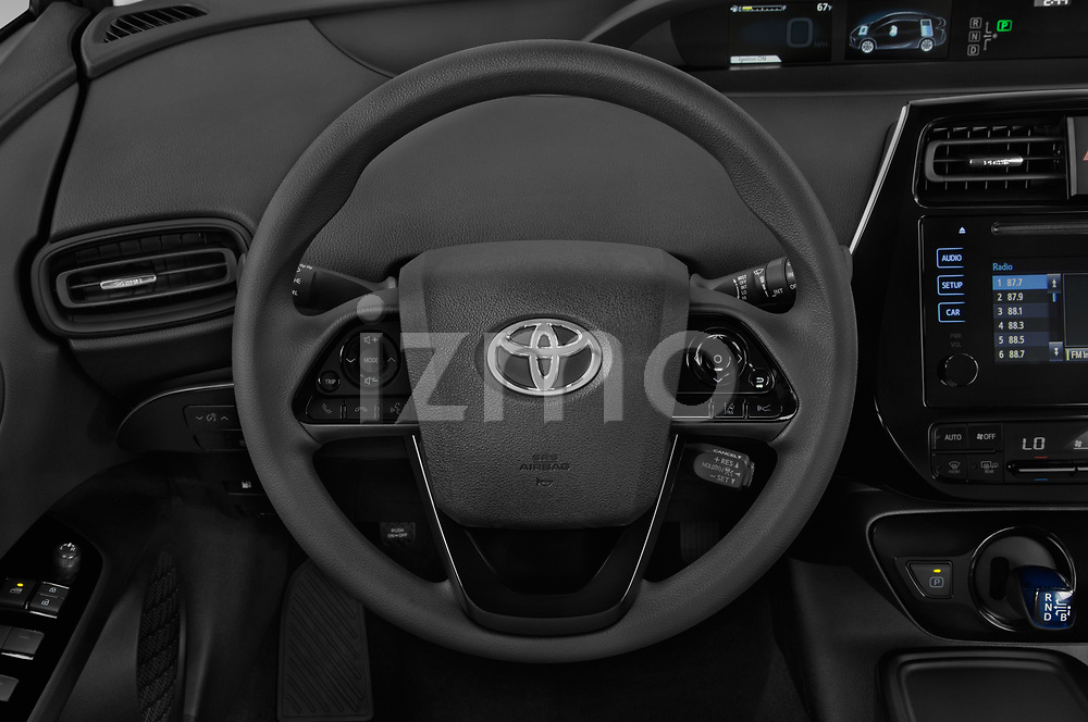 Car pictures of steering wheel view of a 2019 Toyota Prius LE 5 Door Hatchback Steering Wheel