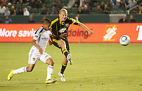 Columbus Crew forward Steven Lenhart (32) gets a shot on goal past LA Galaxy defender Sean Franklin (28) during the first half of the game between LA Galaxy and the Columbus Crew at the Home Depot Center in Carson, CA, on September 11, 2010. LA Galaxy 3, Columbus Crew 1.