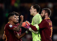 Calcio, Serie A: Roma vs Milan. Roma, stadio Olimpico, 12 dicembre 2016.<br /> Roma's goalkeeper Wojciech Szczesny, second from right, is hugged by teammates Emerson Palmieri, left, Federico Fazio, second from left, and Daniele De Rossi after saving a penalty kicked by Milan's M'Baye Niang, not seen, during the Italian Serie A football match between Roma and AC Milan at Rome's Olympic stadium, 12 December 2016.<br /> UPDATE IMAGES PRESS/Isabella Bonotto