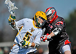 17 March 2012: University of Vermont Catamount Midfielder Andrew Buckanavage, a Freshman from Ridgefield, CT, battles Midfielder Peter Mormino, a Junior from Farmingdale, NY, during action against the Sacred Heart University Pioneers at Virtue Field in Burlington, Vermont. The Catamounts defeated the visiting Pioneers 12-11 with only 10 seconds remaining in their non-conference matchup. Mandatory Credit: Ed Wolfstein Photo