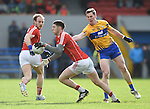 Luke Connolly of Cork in action against Eoin Cleary of Clare during their National Football League game at Cusack Park. Photograph by John Kelly.
