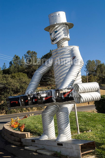 A man made of culvert pipes mail box holder along Highway 108, Sonora, Calif.