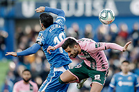 26th January 2020; Coliseum Alfonso Perez, Madrid, Spain; La Liga Football, Club Getafe Club de Futbol versus Real Betis; Antonio Barragan (Betis)  wins the header from Jorge Molina (Getafe CF)