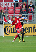25 September 2010:  Toronto FC defender Adrian Cann #12 and San Jose Earthquakes forward Ryan Johnson #19 in action during a game between the San Jose Earthquakes and Toronto FC at BMO Field in Toronto..San Jose Earthquakes won 3-2...