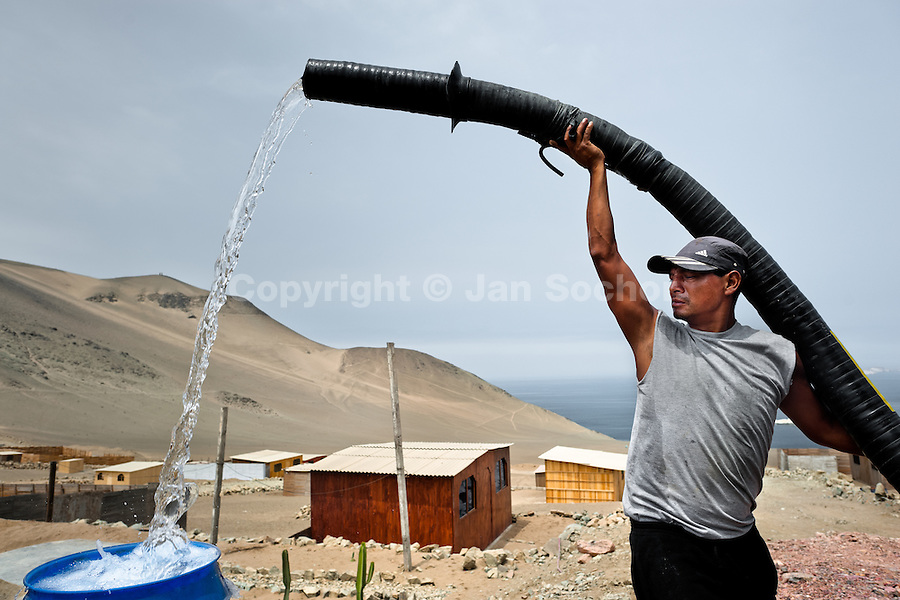 A Peruvian water distribution worker with a hose splashes drinking water into a plastic barrel on the dusty hillside of Pachacútec, a desert suburb of Lima, Peru, 21 January 2015. Although Latin America (as a whole) is blessed with an abundance of fresh water, having 20% of global water resources in the the Amazon Basin and the highest annual rainfall of any region in the world, an estimated 50-70 million Latin Americans (one-tenth of the continent's population) lack access to safe water and 100 million people have no access to any safe sanitation. Complicated geographical conditions (mainly on the Pacific coast), unregulated industrialization (causing environmental pollution) and massive urban poverty, combined with deep social inequality, have caused a severe water supply shortage in many Latin American regions.