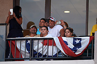 Hall of Fame catcher Ivan Rodriguez (center) uses his cell phone to record his son Dereck pitching in the third inning of the Florida State League All-Star Game on June 17, 2017 at Joker Marchant Stadium in Lakeland, Florida.  FSL North All-Stars  defeated the FSL South All-Stars  5-2.  (Mike Janes/Four Seam Images)