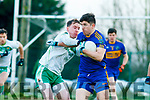 James O'Donnell St Senans being tackled by Eamon Walsh Ballydonoghue during the  North Kerry Championship final played in Moyvane on Sunday.