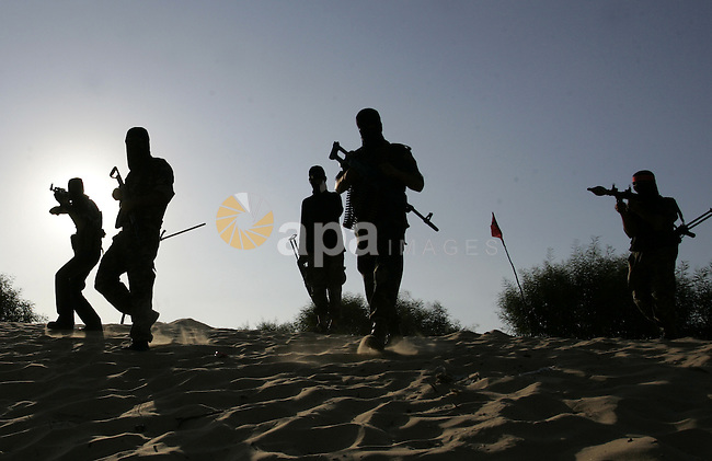 Palestinian militants with the Democratic Front for the Liberation of Palestine (DFLP) take part in a training session in the southern Gaza Strip town of Khan Yunis on October 03, 2011. Photo by Abed Rahim Khatib