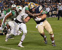 Marshall defender Rodney Allen tackles Pitt running back George Aston. The Pitt Panthers defeated the Marshall Thundering Herd 43-27 on October 1, 2016 at Heinz Field in Pittsburgh, Pennsylvania.