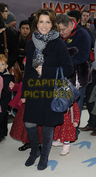 Natasha Kaplinsky.European Premiere of 'Happy Feet Two' at the Empire Leicester Square, London, England..November 20th 2011.2 full length coat jacket blue bag purse boots black grey gray scarf leopard print CAP/CAN.©Can Nguyen/Capital Pictures.