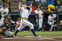 Michigan Wolverines designated hitter Jimmy Kerr (15) follows through on his swing against the Oakland Golden Grizzlies on May 17, 2016 at Ray Fisher Stadium in Ann Arbor, Michigan. Oakland defeated Michigan 6-5 in 10 innings. (Andrew Woolley/Four Seam Images)
