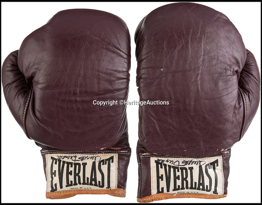 BNPS.co.uk (01202 558833)<br /> Pic: HeritageAuctions/BNPS<br /> <br /> A pair of gloves he used to defeat Floyd Patterson in 1972, which have an estimated sale value of £92,000.<br /> <br /> The iconic WBC Heavyweight Championship belt won by Muhammad Ali following the legendary Rumble in the Jungle in 1974.<br /> <br /> It is being sold by Heritage Auctions in September, with experts predicting the bids could reach as high as £1 million. <br /> <br /> Also included in the sale are the white satin trunks, valued at more than £100,000, worn by the late boxer during the historic contest, as well as the gloves he used to defeat Floyd Patterson in 1972.