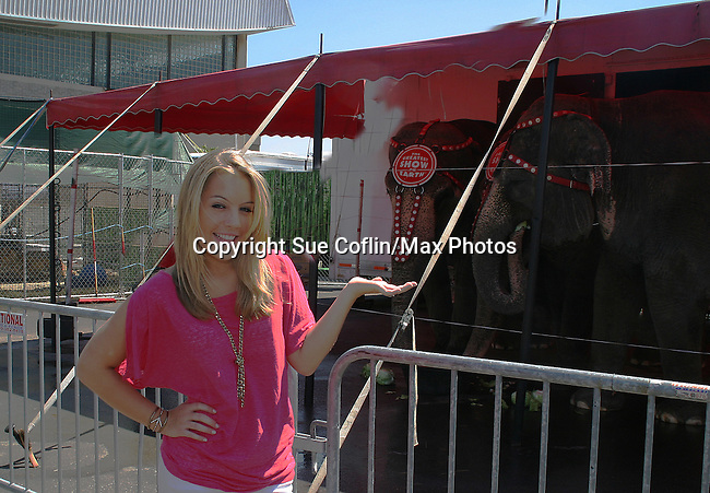 - One Life To Live's Kristen Alderson poses near the elephants as she is guest host and signed autographs at The Coney Island Illuscination presented by Ringling Bros. and Barnum & Bailey - The Greatest Show on Earth on August 28, 2010 at Coney Island Boardwalk, New York. (Photo by Sue Coflin/Max Photos)