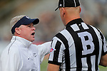 Nevada head coach Brian Polian talks with an official during the first half of an NCAA college football game against Hawaii in Reno, Nev., on Saturday, Oct. 24, 2015. (AP Photo/Cathleen Allison)