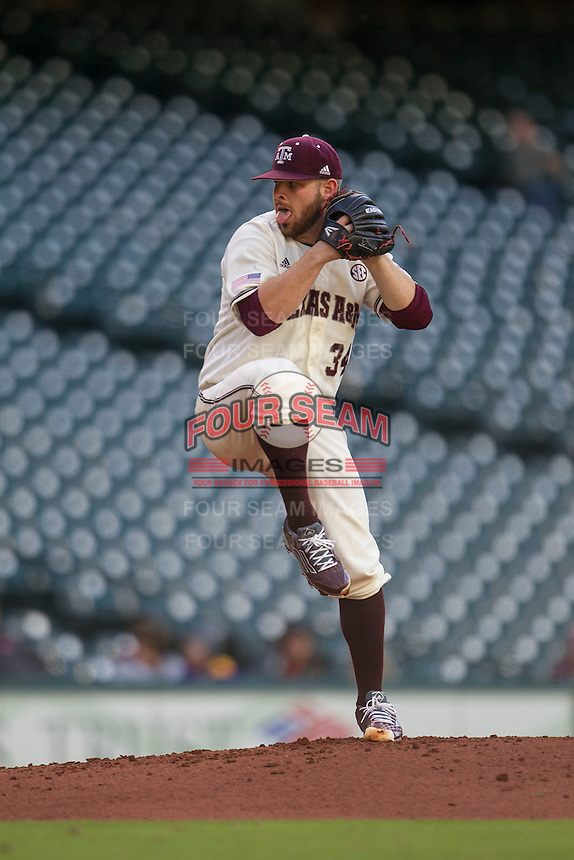 Texas A&M Aggies pitcher A.J. Minter (34) winds up during Houston College Classic against the Nebraska Cornhuskers on March 6, 2015 at Minute Maid Park in Houston, Texas. Texas A&M defeated Nebraska 2-1. (Andrew Woolley/Four Seam Images)
