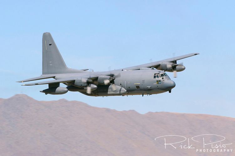 An Alaska Air National Guard Lockheed C-130H Hercules Transport flown by the 144th Airlift Squadron makes a pass over Stead Field in Nevada during the 2006 Reno Air Races. The 144th Airlift Squadron is based at Kulis Air National Guard Base in Anchorage, Alaska. Photographed 09/06