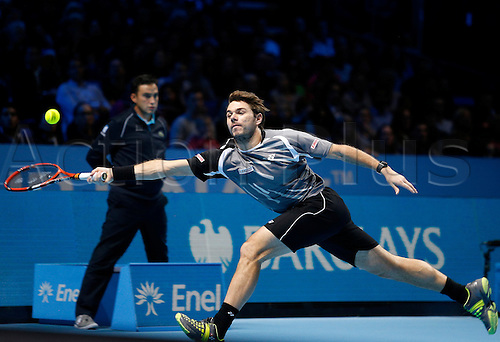 14.11.2014 London, England. Stanislas Wawrinka (SUI) in action against Marin Cilic (CRO) during the Day 6 Barclays ATP World Tour Finals from the O2 Arena.
