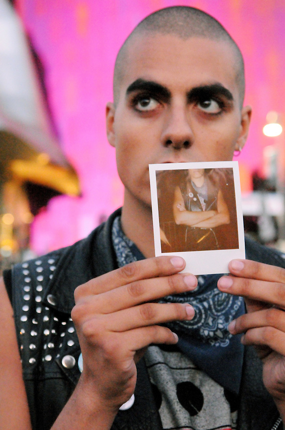 "Tao Sabella Hansen of Copenhagen, Denmark holds a Polaroid photo depicting the studded leather vest, bandana and graphic t-shirt he wore to the 2011 Bumbershoot music and arts festival in Seattle Center on Monday, September 5, 2011. ""I got into punk when I was 18,"" he said. ""Over the years, I've made it my own."""