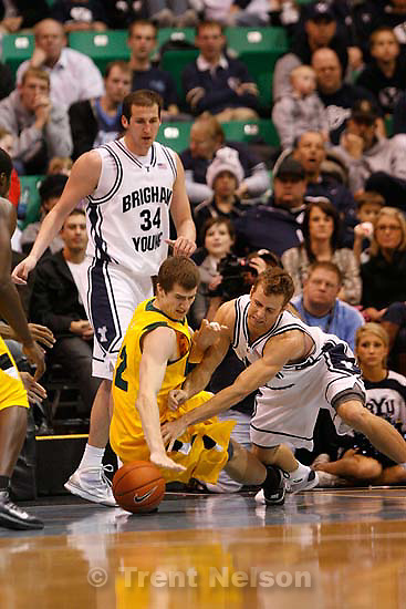 BYU's Jackson Emery (4)  knocks the ball away from San Francisco's Tomas Bruha. BYU vs. USF college basketball, Saturday, December 5 2009 at EnergySolutions Arena in Salt Lake City.
