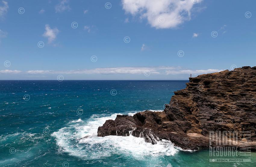 A woman looks out to sea from Halona Beach Cove, Hawai'i Kai, East O'ahu.