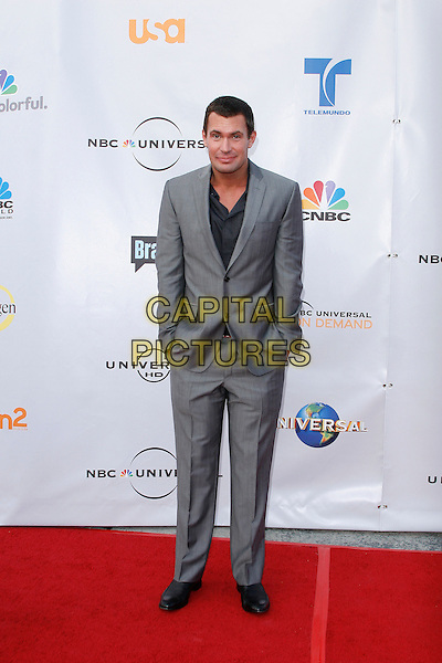 JEFF LEWIS . arriving at the The Cable Show 2010 To Feature An Evening With NBC Universal held at  Universal Studios Hollywood in Universal City, California, USA, .May 12th, 2010..full length grey gray suit hands in pockets .CAP/ROT/AMB.©Adriana M. Barraza /Roth Stock/Capital Pictures
