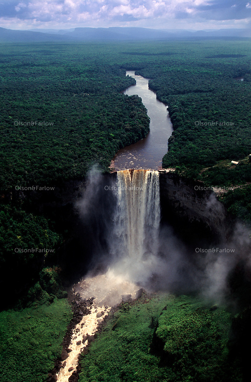 Aerial of Kaieteur Falls.  Kaieteur falls is the highest uninterupted waterfall in the world.  After a sheer drop of 741 feet over the edge of a sandstone plateau, the falls have eroded a gorge, 5 miles long that descends another 81 feet.