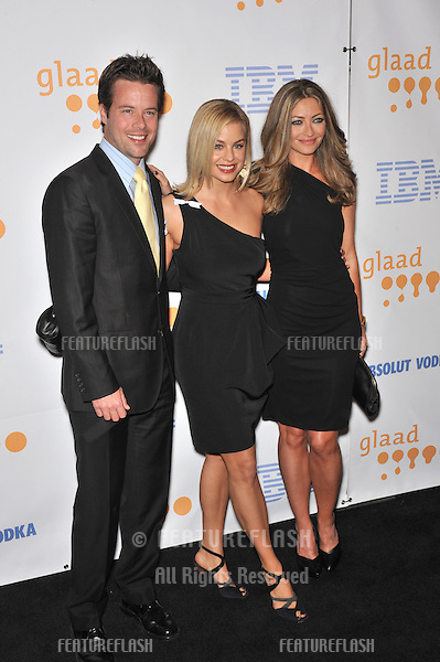 Brad Rowe with Jessica Collins (left) & Rebecca Gayheart at the 20th Annual GLAAD Media Awards at the Nokia Theatre L.A. Live..April 18, 2009  Los Angeles, CA.Picture: Paul Smith / Featureflash