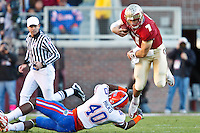 November 27, 2010:   Florida State Seminoles quarterback Christian Ponder (7) leaps over  Florida Gators linebacker Brandon Hicks (40)  during  first half game action between the ACC Conference Florida State Seminoles and the SEC Conference University of Florida Gators at Doak Campbell Stadium in Tallahassee, Florida.