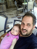 Pictured: Valantis Barkas (R), the son of digger driver Konstantinos Barkas with his daughter in Kos, Greece. <br />