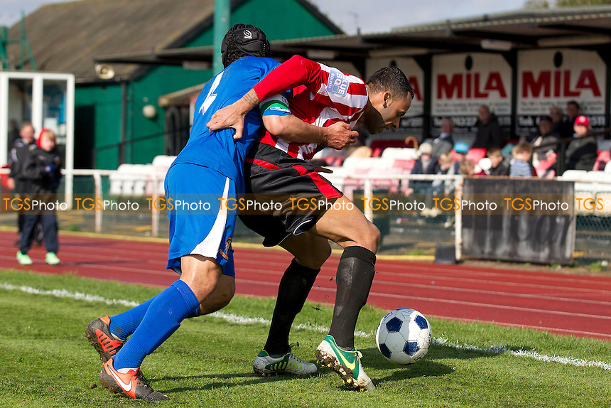 Hayes & Yeading captain Sam Cox gets to grips wit Chris Bourne of AF Hornchurch - AFC Hornchurch vs Hayes & Yeading - Blue Square Conference South Football at The Stadium - 27/04/13 - MANDATORY CREDIT: Ray Lawrence/TGSPHOTO - Self billing applies where appropriate - 0845 094 6026 - contact@tgsphoto.co.uk - NO UNPAID USE.