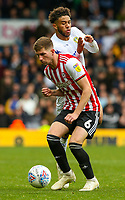 Leeds United's Tyler Roberts runs at Brentford's Chris Mepham<br /> <br /> Photographer Alex Dodd/CameraSport<br /> <br /> The EFL Sky Bet Championship - Leeds United v Brentford - Saturday 6th October 2018 - Elland Road - Leeds<br /> <br /> World Copyright &copy; 2018 CameraSport. All rights reserved. 43 Linden Ave. Countesthorpe. Leicester. England. LE8 5PG - Tel: +44 (0) 116 277 4147 - admin@camerasport.com - www.camerasport.com