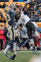 Pitt wide receiver Tyler Boyd (23) makes a circus catch over Duke defender Evrett Edwards (2). The Duke Blue Devils defeated the Pitt Panthers 51-48 at Heinz Field, Pittsburgh Pennsylvania on November 1, 2014.