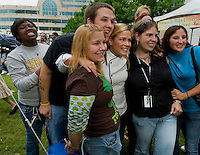 Iron Chef America star Cat Cora has her picture taken with fans during the 2008 Charlotte Shout culinary festival in downtown Charlotte, NC. Shout is a month-long celebration of art, culture, entertainment and culinary excellence.