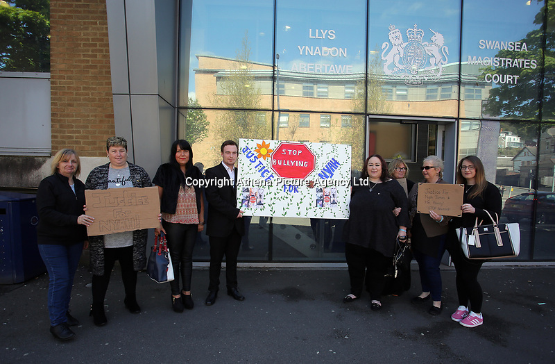"""Pictured: Jordan Clements (4th L) with Dominique Williams (5th L) joined by friends and family, outside Swansea Magistrates Court. Tuesday 02 May 2017<br /> Re: A man who sent abusive messages to girls he believed had bullied his late sister has been spared jail by a judge, who said he had been """"irrational with grief"""".<br /> Jordan Clements' 14-year-old sister Nyah James was found dead at her home in Blaenymaes, Swansea, in February.<br /> Swansea Magistrates' Court heard Clements later targeted four girls.<br /> The 20-year-old pleaded guilty to two counts of harassment and two counts of sending offensive communications.<br /> Clements was ordered to complete a 125-hour community order as well as 15 days of rehabilitation.<br /> District Judge Neale Thomas said he could have sent Clements to prison because of the targeted and frightening online messages he sent to his four victims, which the court heard were abusive and threatening.<br /> However, Judge Thomas said the defendant had become """"irrational with grief"""" following Nyah's death."""
