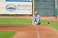 The grounds crew prepares the field prior to the game between the Great Falls Voyagers and the Ogden Raptors on July 17, 2014 at Lindquist Field in Ogden, Utah. (Stephen Smith/Four Seam Images)