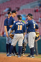 Durham Bulls pitcher Mike Montgomery #38 talks with pitching coach Neil Allen #17 as Ryan Roberts #13, Shelley Duncan #47, and Chris Gimenez #16 listen in as during a game against the Buffalo Bisons on June 24, 2013 at Coca-Cola Field in Buffalo, New York.  Durham defeated Buffalo 7-1.  (Mike Janes/Four Seam Images)