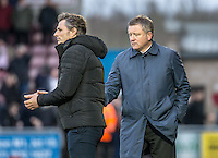 Northampton Town Manager Chris Wilder walks over to Wycombe Wanderers Manager Gareth Ainsworth after the final whistle during the Sky Bet League 2 match between Northampton Town and Wycombe Wanderers at Sixfields Stadium, Northampton, England on the 20th February 2016. Photo by Liam McAvoy.