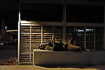 """A man takes a rest as night falls at """"Levinsky Garden"""" in southern Tel Aviv, where African migrants can get food from aid organizations and an outdoor place to sleep."""
