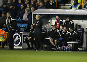 9th February 2018, The Den, London, England; EFL Championship football, Millwall versus Cardiff City; Tim Cahill of Millwall looks on from the bench during the 2nd half with Millwall manager Neil Harris looking on from the touchline