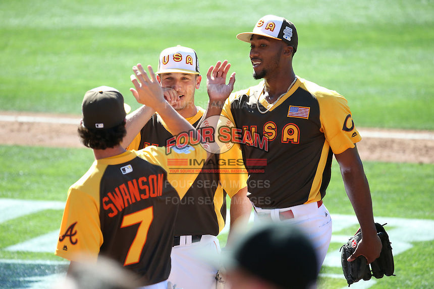 Dansby Swanson, Alex Bregman, and Amir Garrett of the USA Team during a game against the World Team during The Futures Game at Petco Park on July 10, 2016 in San Diego, California. World Team defeated USA Team, 11-3. (Larry Goren/Four Seam Images)