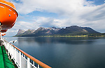 Steep mountains of Grytoya island, Troms county, northern Norway from Hurtigruten ferry ship
